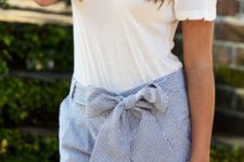 With white t-shirt and striped shorts