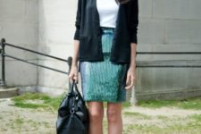 With white t-shirt, black cardigan, black leather bag and ankle strap shoes