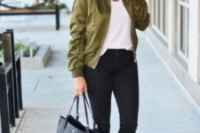 With white t-shirt, black skinny pants, tote bag and lace up flats