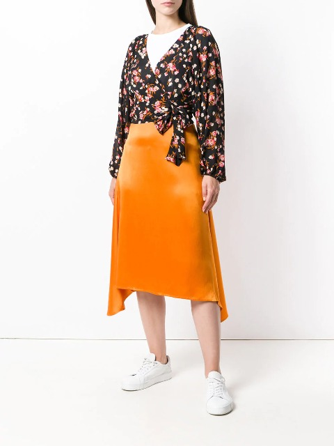 With white t-shirt, orange midi skirt and white sneakers