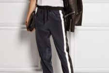 With white top, leather jacket, black bag and ankle strap shoes