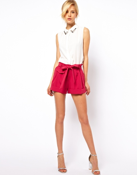 With white top, red shorts and silver shoes