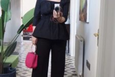 With wide leg pants, pink bag and gray shoes