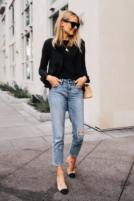a black blouse, blue straight leg jeans, nude and black slingbacks and a nude bag
