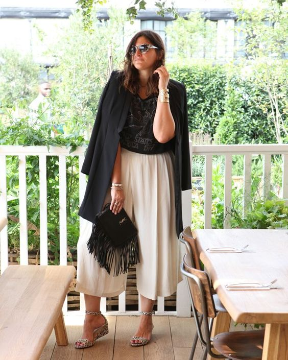 a black printed tee, creamy culottes, printed wedges and an oversized black blazer