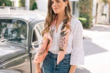 a blue deconstructed denim mini, a white lace bell sleeve blouse and a woven bag for a touch of boho