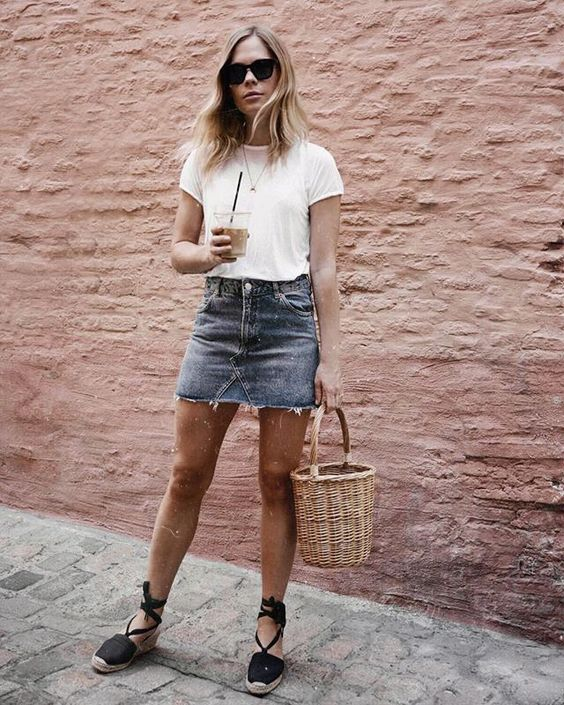a deconstructed denim mini, a white tee, black espadrilles and a basket for summer