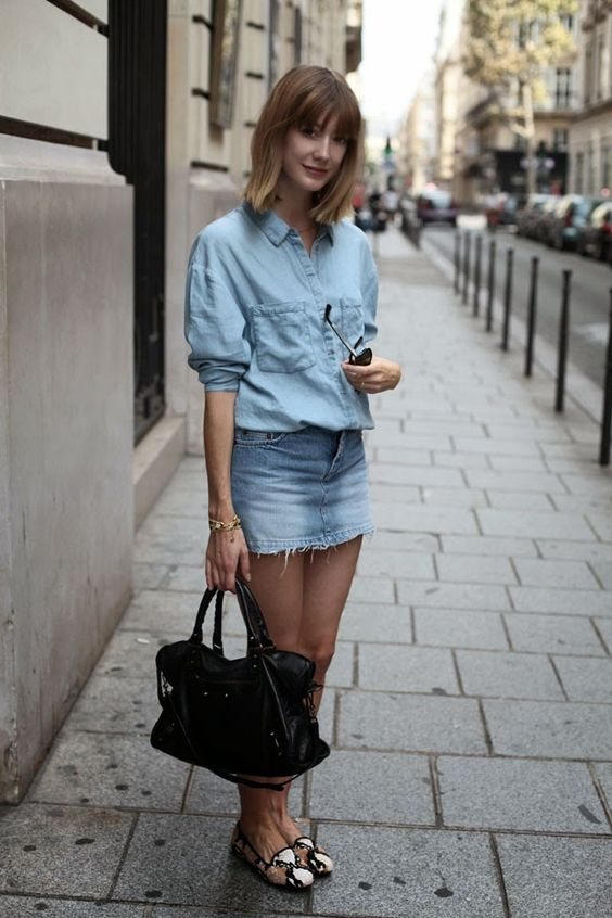 a double denim look with an oversized chambray shirt, a deconstructed blue denim mini, snake printed loafers and a black bag