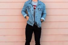 a gree graphic tee, black jeans, a blue denim jacket and white sneakers for a transitional casual look