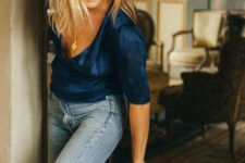 a navy silk wrap blouse,blue flare jeans and neutral slingbacks for a relaxed feel