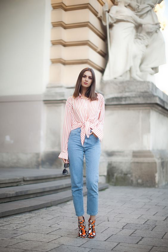 a striped shirt, blue mom jeans and colorful strappy shoes for a touch of color