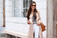 a striped tee, white straight leg jeans, nude heeled sandals, a neutral trench, a camel bag