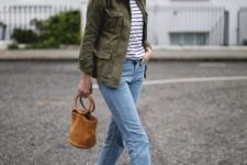 a striped top, blue distressed straight leg jeans, an olive green jacket, espadrilles and a bucket bag
