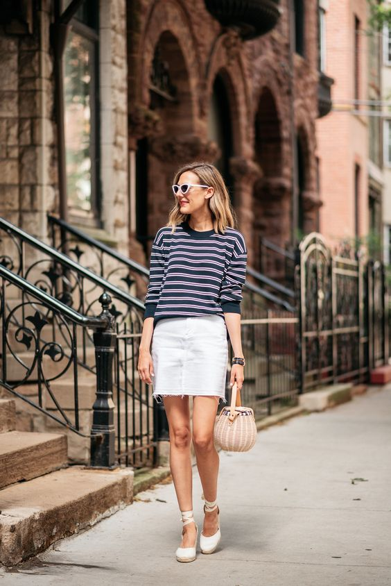 a white denim mini, a striped top, a basket bag and espadrilles for a touch of edge