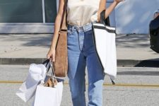 a white silk top, blue high waisted jeans, nude heels and a brown suede bag