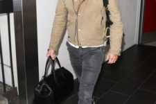 a white t-shirt, a tan moto jacket, grey jeans, tan Chelsea boots and a black bag