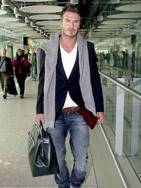 a white tee, a black blazer, blue jeans and a grey sweater in case of cold for a casual airport look