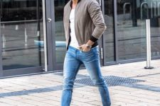 a white tee and sneakers, a grey bomber jacket and blue skinnies for a modern transitional look