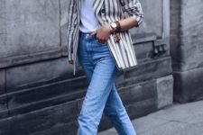 a white tee, blue cropped straight leg jeans, nude heeled sandals, a striped blazer and a camel hat