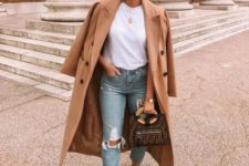 a white tee, blue distressed straight leg jeans, camel booties and a camel coat plus a brown bag