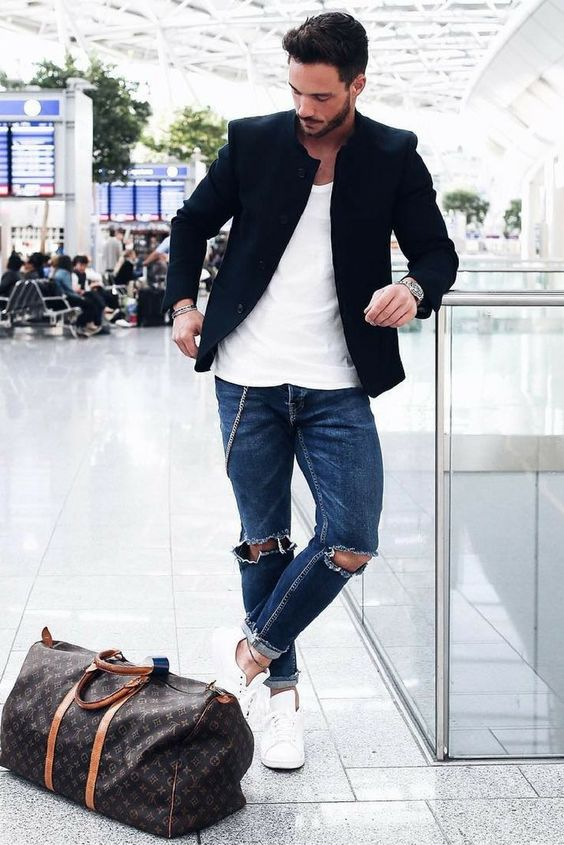 a white tee, blue ripped jeans, a black blazer and white sneakers is a simple and relaxed look