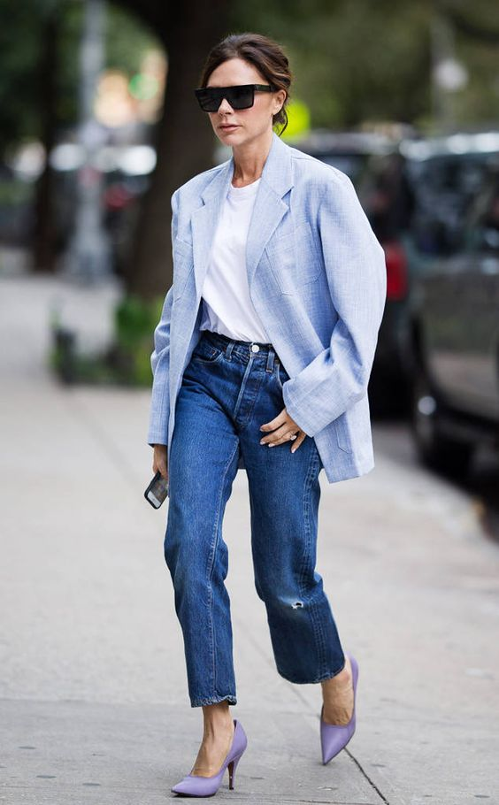 a white tee, blue ripped straight leg jeans, a light blue blazer and purple heels by Victoria Beckham