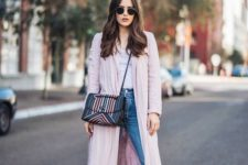 a white tee, blue straight leg jeans, black sock boots, a pink trench and a bright striped bag