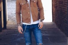 a white tee, white sneakers, blue ripped skinnies, a rust-colored denim jacket