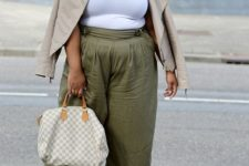 a white top, olvie green culottes, nude shoes, a neutral jacket and a printed bag