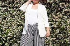a white top, striped black and white culottes, white mules and a white blazer for work