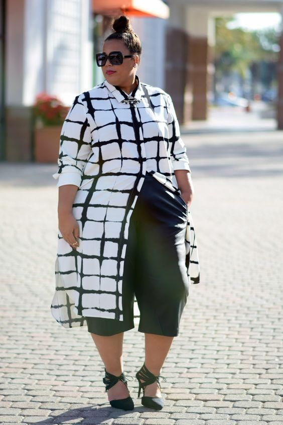 black culottes, a long black and white button down and black strappy shoes
