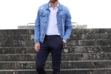 black pants and a white shirt are made more casual with a blue denim jacket and white sneakers