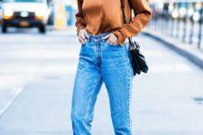 blue high waisted mom jeans, an amber silk top, snake print slingbacks, a black bag