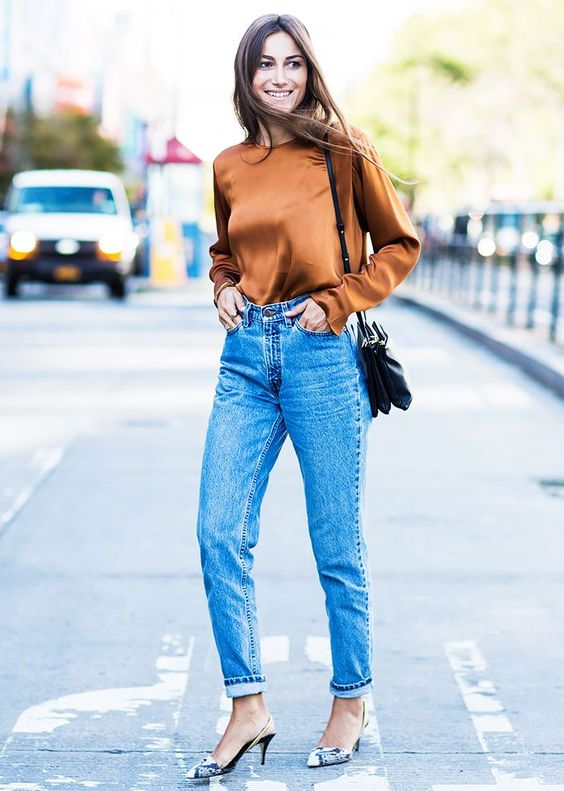 blue high waisted mom jeans, an amber silk top, snake print slingbacks, a black bag