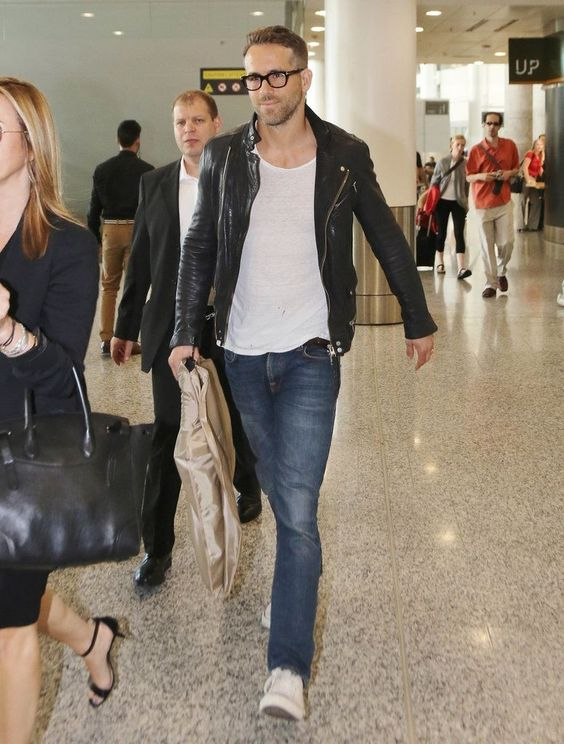blue jeans, a white tee, a black leather jacket and white sneakers for a badass airport look