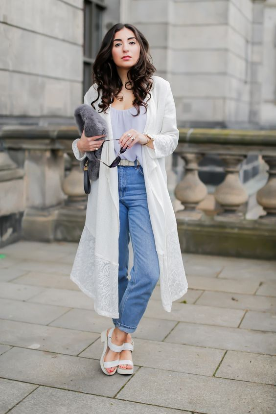 blue mom jeans, a pastel top, a lacey duster, white birkenstocks and a fur clutch