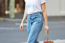 blue mom jeans, white sneakers, a white tee and an amber tote for an everyday look