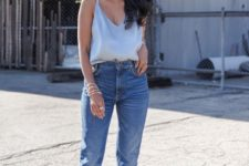 creamy heels, blue high waisted jeans and a grey silk spaghetti strap top