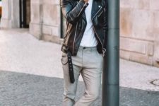 grey cropped pants, a white tee, black sneakers and a black leather jacket for a casual feel