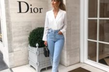 light blue cropped mom jeans, a white shirt, black block heels and a small black bag