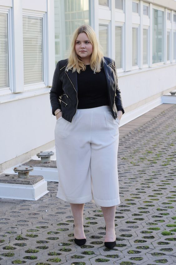 white culottes, a black tee, a black denim jacket, black shoes for a chic look