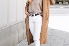 white jeans, a grey silk spaghetti strap top, amber booties and a tan long cardigan