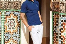 02 a navy polo shirt, white shorts, navy loafers make up a chic monochromatic outfit