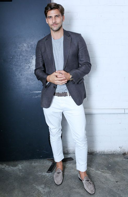 a summer work-appropriate look with white pants, a grey tee, a grey blazer and grey loafers with tassels