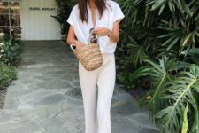 02 a white oversized button down with short sleeves, pleated cropped pants, black slippers and a straw bag