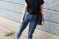 03 a black tee, blue jeans, black dad sandals, a black bag make up a comfy look for summer