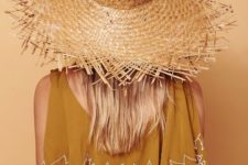03 a boho mustard dress with printing paired with a fringe brim straw hat is a cool combo