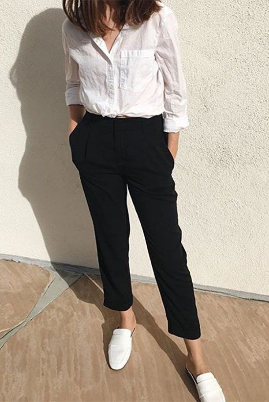 a white button down, black cropped pants, white slipper mules that add a bit of edge to the look