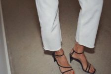 03 white jeans with a raw hem paired with black heeld sandals with square toes