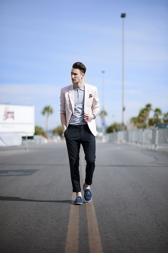 a creative work look with a grey polo shirt, a blush blazer, black chinos and blue loafers